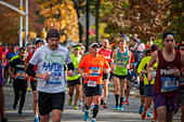 New York, USA. 06th Nov, 2016. Runners pass through Harlem in New York near the 22 mile mark near Mount Morris Park on Sunday, November 6, 2016 in the 46th annual TCS New York City Marathon. About 50,000 runners from over 120 countries are expected to compete in the race, the world's largest marathon. ( © Richard B. Levine) © Richard Levine/Alamy Live News - Stock Image - H7M6PD