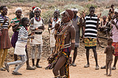 Hamer woman dancing at a bull jumping ceremony near Turmi in the Omo Valley, Ethiopia - Stock Image - DY8NPF