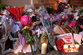 Goring, UK. 26th Dec, 21016.  Flowers, candles and words of sympathy were left outside George Michael's home in Goring. George Michael passed away yesterday.© Pete Lusabia/Alamy Live News - Stock Image - HF0C8E