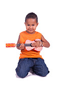 A portrait of a cute asian boy with guitar - Stock Image - D04DA9