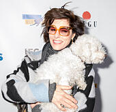 New York, NY, USA - December 19: Actress Parker Posey with her dog Gracie attend Paw Prints 1st Annual Paw-liday party screening of 'Best in Show' at IFC center Credit: Sam Aronov/Alamy Live News - Stock Image - KRFE90