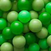 Green balls - Stock Image - BJHWB3