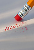 Studio shot of pencil erasing the word errors from piece of paper - Stock Image - C3HK66