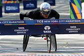 Marcel Hug of Switzerland crosses the finish line to win the men's wheelchair division of the 2016 New York City Marathon in Central Park in the Manhattan borough of New York City, U.S., November 6, 2016.  REUTERS/Mike Segar - Stock Image - H9TT28