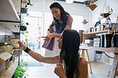 Women shopping for housewares in shop - Stock Image - F1G263
