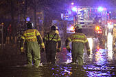 Luebeck, Germany. 04th Jan, 2017. Members of the local fire brigade in Luebeck, Germany, 04 January 2017. The Federal Maritime and Hydrographic Agency (BSH) forecast storm tides along the German Baltic coast with water levels rising to 1.5 meters above average. Photo: Bodo Marks/dpa/Alamy Live News - Stock Image - HG6EHX