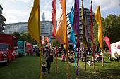 People gathering to hang out, listen to bands and other activities at the Blue Ribbon Village. Thames Festival London UK. - Stock Image - E7EENE