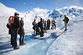Ice trekking at Perito Moreno glacier, Lago Argentino, Los Glaciares National Park, near El Calafate, Patagonia, Argentina - Stock Image - C90G35