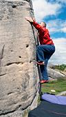 rock climber bouldering at Burbage Edge South, Derbyshire, Peak District National Park, England, UK, United, Kingdom, Great, Bri - Stock Image - DC879J