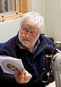 Drummer and publican John Halsey at local radio station Cambridge 105 - Stock Image - HEHAEF