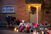 Goring, UK. 26th Dec, 21016.  Flowers, candles and words of sympathy were left outside George Michael's home in Goring. George Michael passed away yesterday.© Pete Lusabia/Alamy Live News - Stock Image - HF0C8P