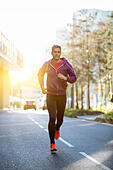 athlete with earphones running in the city - Stock Image - H7MHAH
