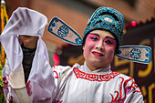 Chinese man wearing makeup parades at the Lunar New Year Festival in Chinatown. - Stock Image - DT5MA0