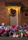 Goring, UK. 26th Dec, 21016.  Flowers, candles and words of sympathy were left outside George Michael's home in Goring. George Michael passed away yesterday.© Pete Lusabia/Alamy Live News - Stock Image - HF0C8R