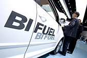 Bifuel lettering on a VW Touran, Volkswagen AG group, driven by either natural gas or gasoline, at the 63. Internationale - Stock Image - BXBHCX