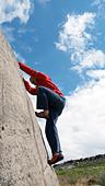 rock climber bouldering at Burbage Edge South, Derbyshire, Peak District National Park, England, UK, United, Kingdom, Great, Bri - Stock Image - DC875M