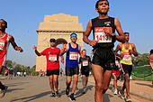 Sep. 30, 2012 - New Delhi, India - Delhi residents participate in the New Delhi Half Marathon as they run by the famous New Delhi landmark, the India Gate.(Credit Image: © Subhash Sharma/ZUMAPRESS.com) - Stock Image - CM48MJ