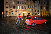 Luebeck, Germany. 04th Jan, 2017. A car in a flooded street in Luebeck, Germany, 04 January 2017. The Federal Maritime and Hydrographic Agency (BSH) forecast storm tides along the German Baltic coast with water levels rising to 1.5 meters above average. Photo: Bodo Marks/dpa/Alamy Live News - Stock Image - HG6EHD