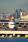 Regional airliner at London City Airport, England, UK - Stock Image - CYHHPJ