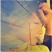 Reflection of a boy looking out of a train window on the north of Barcelona coast, El Maresme, Catalonia, Spain - Stock Image - S02N8D
