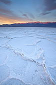 Sunrise over salt polygons and patterns at Badwater Salt Flats in Death Valley National Park, California, USA - Stock Image - CEACP2
