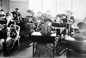 Children reading at desks in room of open air school, Providence - Stock Image - C5DPJ2