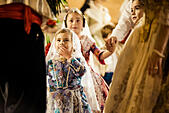 Valencia, Spain. March 18th, 2014: A little Fallera finally offers her flower bouquet to the Virgin and hands it over to be placed at the virgins image. © matthi/Alamy Live News - Stock Image - DX658F