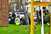 London, United Kingdom. 31st October 2017. A man has been rescued from a house fire in Leythe Road in Acton, London. The man received medical attention by the roadside before being transported to a London hospital. Credit: Peter Manning/Alamy Live News - Stock Image - KFPNH7