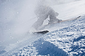 Low section of a person skiing - Stock Image - CMW0R5
