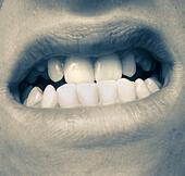 Clouse up of a mouth with strong teeth - Stock Image - S0C917