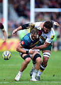 London, UK. 8th October, 2016. Luke Wallace of Harlequins is tackled during Aviva Premiership Rugby game between Harlequins and Northampton Saints at Twickenham Stoop on Saturday. © Taka Wu/Alamy Live News - Stock Image - H3GMXP