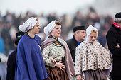 Netherlands, Scheveningen. Bicentenary. Historic landing at Scheveningen beach. Fishermen and women in traditional costume - Stock Image - DMNXGK