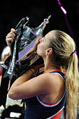 Singapore. 30th Oct, 2016. Dominika Cibulkova of Slovakia kisses the trophy during the victory ceremony after winning the WTA Finals match against Angelique Kerber of Germany at Singapore Indoor Stadium, Oct. 30, 2016. Cibulkova won 2-0. © Then Chih Wey/Xinhua/Alamy Live News - Stock Image - H6KCC6
