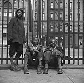 Three African American boys in Harlem. May 1943 photo by Gordon Parks. - Stock Image - CWCAB6