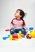 Indian baby boy playing over over white background and looking at camera - Stock Image - HTAWG2