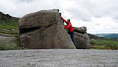 rock climber bouldering at Burbage Edge South, Derbyshire, Peak District National Park, England, UK, United, Kingdom, Great, Bri - Stock Image - DC874N