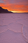 Sunrise over salt polygons and patterns at Badwater Salt Flats in Death Valley National Park, California, USA - Stock Image - CEACKT
