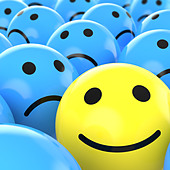 close up of a yellow happy smiley between many blue sad others as concept for unique, optimistic, positive, etc. - Stock Image - BNY97C