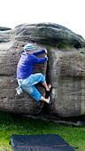 rock climber bouldering at Burbage Edge South, Derbyshire, Peak District National Park, England, UK, United, Kingdom - Stock Image - DC86TF