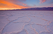 Sunrise over salt polygons and patterns at Badwater Salt Flats in Death Valley National Park, California, USA - Stock Image - CEACN8