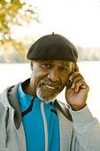 Senior man using a mobile phone, Sweden. - Stock Image - BHH4HX