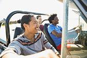 Male friends enjoying road trip - Stock Image - DRPA84