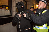 London, United Kingdom. 05th Nov, 2017. Million Mask March 2017 takes place in central London. A protester is arrested. Credit: Peter Manning/Alamy Live News - Stock Image - KG9THD