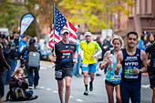 New York, USA. 06th Nov, 2016. Runners pass through Harlem in New York near the 22 mile mark near Mount Morris Park on Sunday, November 6, 2016 in the 46th annual TCS New York City Marathon. About 50,000 runners from over 120 countries are expected to compete in the race, the world's largest marathon. ( © Richard B. Levine) © Richard Levine/Alamy Live News - Stock Image - H7M6MH