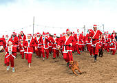 Perranporth, Cornwall, UK. 18th December 2016. Santa's on the sand an annual charity run on Perranporth beach in Cornwall, UK Credit: Kevin Britland/Alamy Live News - Stock Image - HE6421