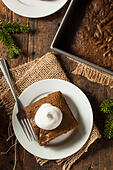 homemade-brown-gingerbread-cake-with-whi