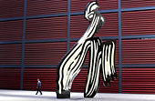 a-visitor-walks-past-a-sculpture-on-disp
